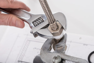 Screwing plumbing fittings, closeup