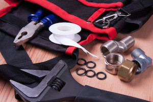 Professional plumbing tools and seals placed in the workplace.