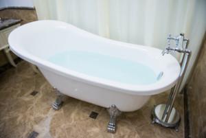 luxury bathtub in bathroom, water