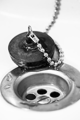 Sink and plug, vertical black and white image